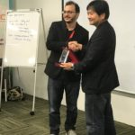 Homam Alghorani founder of Wonderland Technologies Sdn Bhd receiving the finalist NTT startup challenge award